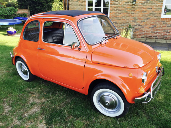 Fully restored 1972 Fiat 500 in coral red