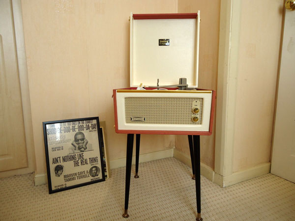Restored 1960s Dansette Bermuda record player with legs