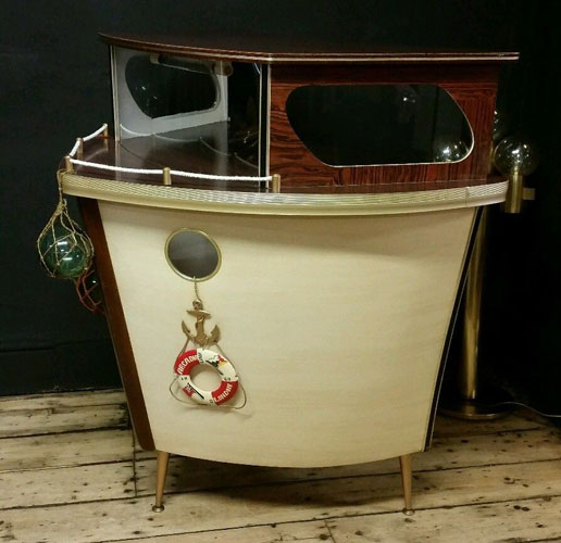 Restored 1950s boat-shaped cocktail bar