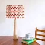 Retro-style barkcloth table lamps and cushions at Hunkydory Home