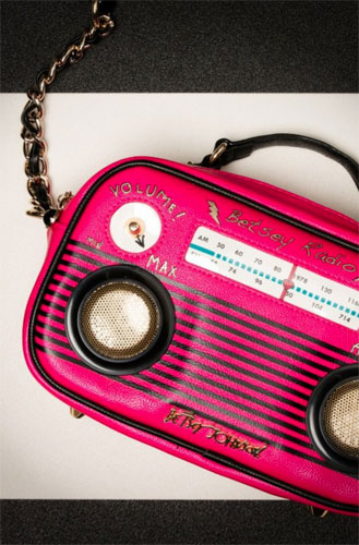 Vintage-style Turn On The Music Radio Bag with working speakers by Betsey Johnson
