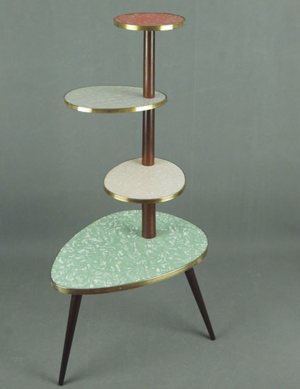 1950s plant stand with patterned tops on eBay