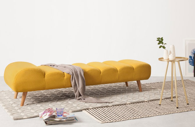 Midcentury-style Caterpillar Day Bed at Made returns in bold yellow