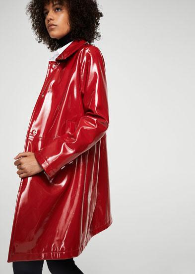 Retro vinyl trench coat at Mango