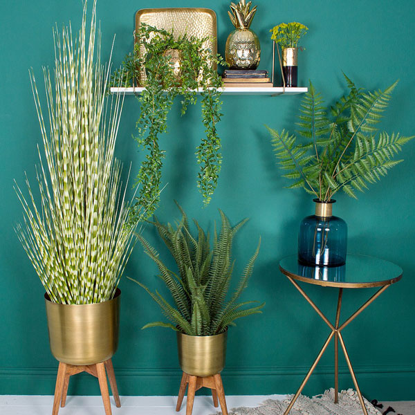 Midcentury-style brass planters at Audenza
