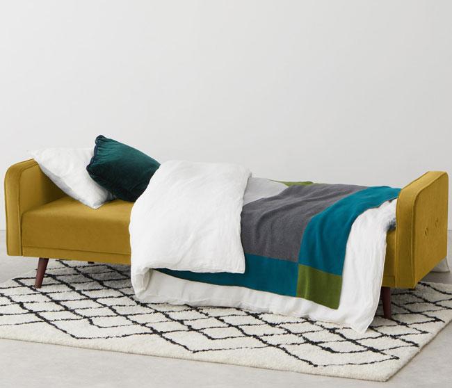 1. Chou click clack sofa bed at Made