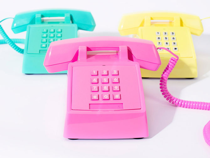 1980s-style neon push button telephones at Firebox