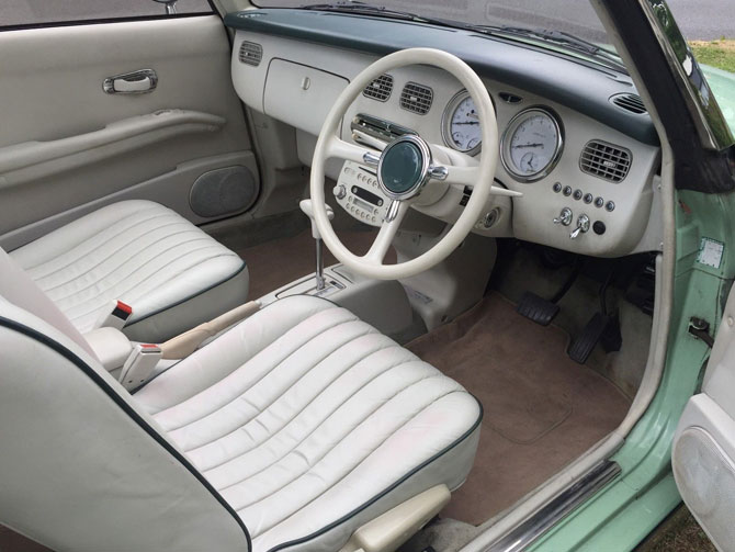 Nissan Figaro in emerald green on eBay