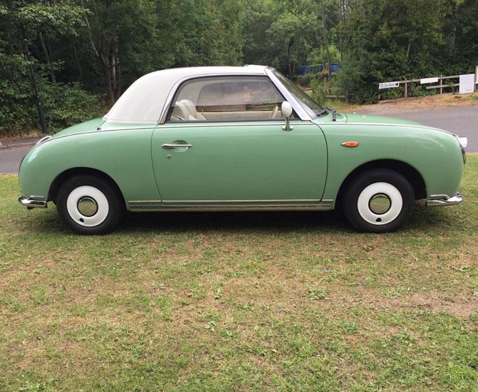 Nissan Figaro in emerald green on eBay
