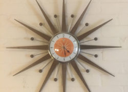 10. Midcentury modern sunburst wall clock by Royale Enamel