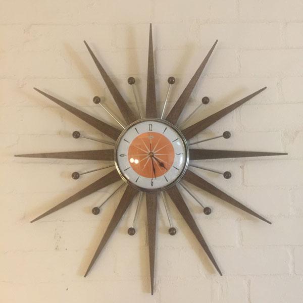 10. Midcentury modern sunburst wall clock by Royale Enamel
