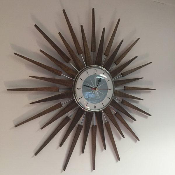 1. Handmade 1950s-style sunburst clock by Royale Enamel